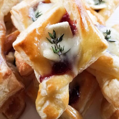 A plate of delicious raspberry brie tarlets. A perfect holiday party appetizer!