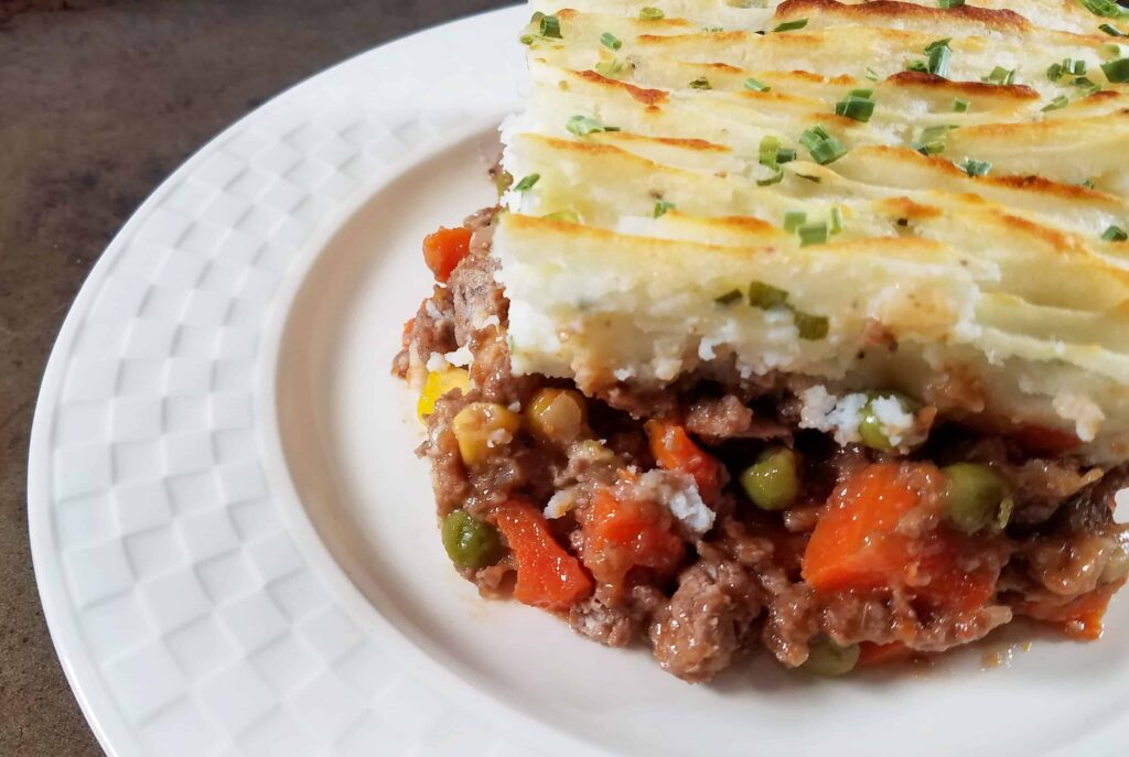 A close up of shepherd's pie on a plate.